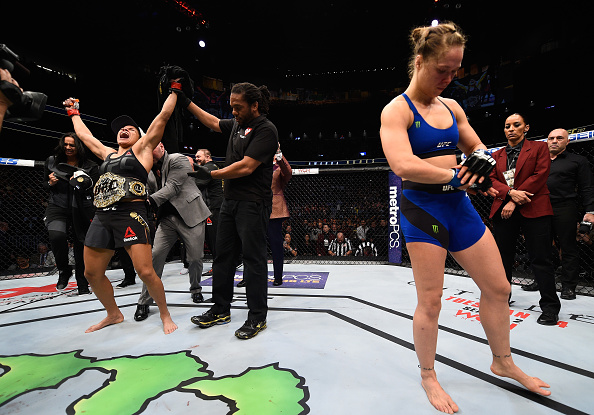 LAS VEGAS, NV - DECEMBER 30: Amanda Nunes of Brazil (left) reacts to her victory over Ronda Rousey (right) in their UFC women's bantamweight championship bout during the UFC 207 event at T-Mobile Arena on December 30, 2016 in Las Vegas, Nevada.  (Photo by Jeff Bottari/Zuffa LLC/Zuffa LLC via Getty Images)